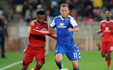 Orlando Pirates defender, Siyabonga Sangweni and Supersport United striker, Jeremy Brockie, fight for the ball during the PSL match on 11 August 2015. The match was called off due to poor lighting. Picture: PSL.