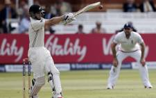 New Zealand batsman Kane Williamson (L) plays a shot against England during the second day of the first cricket Test match between England and New Zealand at Lord's cricket ground in London, on 22 May, 2015. Picture: AFP