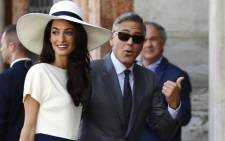 US actor George Clooney and his Amal Alamuddin. Picture: AFP.