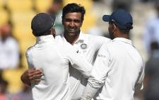 FILE: Indian cricketer Ravichandran Ashwin (C) celebrates with captain Virat Kohli (L) after India won the second Test cricket match against Sri Lanka at the Vidarbha Cricket Association Stadium in Nagpur on 27 November 2017. Picture: AFP