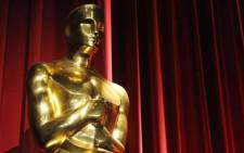 An Oscars statue is seen before the start of the 83rd Annual Academy Awards Nominations Announcement 25 January 2011. Picture: AFP