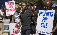 A small group of protesters under the banner of an organisation called 'Speak the Truth' demonstrating against false prophets on 14 March in Braamfontein. Picture: Ihsaan Haffejee/EWN.