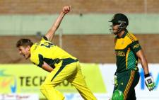 FILE: Australia's bowler James Faulkner bowls as South Africa's batsman Faf du Plessis looks on during a cricket match as part of a One Day International tri-series at the Harare Sports Club, on 27 August 2014. Picture: AFP.