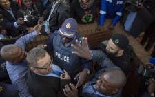 BLF confront AfriForum CEO Kallie Kriel outside the Randburg magistrates court on 12 July 2018 following Duduzane Zuma's court appearance. Picture: Thomas Holder/EWN
