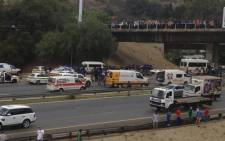 A picture taken from Killarney Mall shows police and paramedics on the M1 highway after a shootout on 22 October 2013. Picture: via Twitter @footballmurph