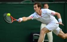 Britain's Andy Murray plays a forehand shot during his men's singles semi-final match against France's Jo-Wilfried Tsonga on day 11 of the 2012 Wimbledon Championship. Picture: AFP