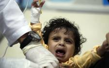 FILE: A Yemeni child, suspected of being infected with cholera, receives treatment at a hospital in Sanaa on 15 May 2017. Picture: AFP