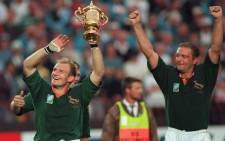 FILE: South African captain Francois Pienaar (left) and teammate Hannes Strydom (right) celebrate winning the Rugby World Cup at Ellis Park Stadium in Johannesburg on June 24, 1995. Picture: AFP