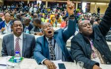 War Veterans leader Christopher Mutsvangwa (C) celebrates the dismissal of President Robert Mugabe as leader of the ruling ZANU-PF party on November 19, 2017 in Harare. Picture: AFP