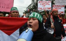 Muslim demonstrationers shout anti-US slogans during a demonstration near the US embassy in Manila on December 13, 2017, against US President Donald Trump's recognition of Jerusalem as the capital of Israel.  Picture: AFP.