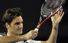 Roger Federer suffered a semi-final defeat to Novak Djokovic in the Australian Open on 27 January 2011. Picture: AFP