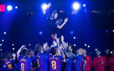 Barcelona's Andres Iniesta and team mates celebrate after winning the La Liga championship. Picture: Twitter @FCBarcelona.