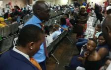 Home Affairs Minister Malusi Gigaba engaging with clients during a visit to the Orlando West offices. Picture: @HomeAffairsSA/Twitter.
