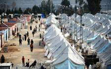 FILE: Syrian refugees walk among tents at Karkamis refugee camp on 16 January 2014 near the town of Gaziantep, south of Turkey. Picture: AFP.