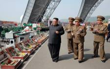 This undated photo released by North Korea's official Korean Central News Agency (KCNA) on 13 May 2017 shows North Korean leader Kim Jong-Un (L) at an exhibition of utensils and tools, finishing building materials and sci-tech achievements organised by the Ministry of the People's Armed Forces. Picture: AFP.