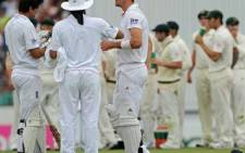 England batsmen Alastair Cook (L) and Kevin Pietersen (C) wait for a third umpire decision which saw Cook given not out on 04 January 2011. AFP