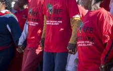 EFF members hold hands during the party's march in Coligny in the North West against what residents call bias & inefficient police in the area on 19 May 2017. Picture: Reinart Toerien/EWN.