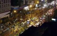 An image grab taken from a handout video released by Iran's Mehr News agency reportedly shows a group of men walking down a street in Tehran on 30 December 2017. Picture: AFP.