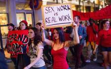 Strip club dancers, workers, and supporters march in in New Orleans on 1 February 2018, to protest the recent police raids that cited and closed several strip clubs on Bourbon Street. Picture: AFP