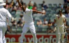 South African bowler Vernon Philander (C) celebrates after he dismissed Australian batsman Ricky Ponting on day two of the third cricket Test between South Africa and Australia at the WACA ground in Perth on December 1, 2012. Picture: AFP.