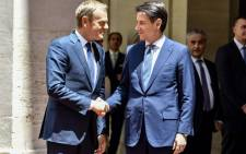 European Council President Donald Tusk (left) shake hands with Italian Prime Minister Giuseppe Conte (R) on June 20, 2018 at Chigi palace in Rome. Picture: AFP