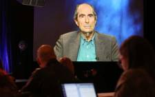 FILE: In this file photo taken on 14 January 2013, US novelist Philip Roth is projected onscreen as he speaks via satellite video feed to the audience during the PBS panel of 'American Masters Philip Roth: Unmasked' at the 2013 Winter Television Critics Association Press Tour at the Langham Huntington Hotel & Spa in Pasadena, California. Picture: AFP
