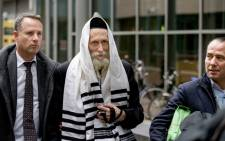 FILE: Israeli Rabbi Eliezer Berland (C), who is suspected of sexual abuse in Israel, arrives at court in Haarlem, on 17 November 2014, with his lawyer Louis de Leon (R). Picture: AFP/ANP/Sander Koning.
