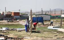 FILE: Dunoon residents rebuild their structures on 4 April 2018, after Metro Police broke them down for the third time this year. Picture: Bertram Malgas/EWN