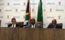 Public Works Minister Thulas Nxesi (centre) at a press conference in Pretoria on 19 July 2018. Picture: Pelane Phakgadi/ EWN.