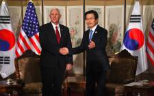 US Vice President Mike Pence (L) shakes hands with South Korea's Prime Minister and acting President Hwang Kyo-Ahn (R) during their meeting in Seoul on 17 April 2017. Pence arrived at the gateway to the Demilitarised Zone dividing the two Koreas, in a show of US resolve a day after North Korea failed in its attempt to test another missile. Picture: AFP