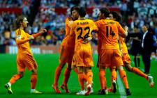 Real Madrid players celebrate with Sergio Ramos after his goal against Real Valladolid on 7 May 2014. Picture: Facebook.