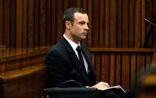 FILE: Oscar Pistorius listens to a witness testifying at the High Court in Pretoria on 10 March 2014. Picture: Pool