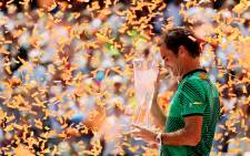 Roger Federer of Switzerland holds the winner's trophy after defeating Rafael Nadal of Spain during the Men's Final and day 14 of the Miami Open at Crandon Park Tennis Center on 2 April, 2017 in Key Biscayne, Florida. AFP.