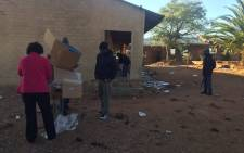 Police have escorted Independent Electoral Commission (IEC) officials into some voting stations in Vuwani after removing barricades set up by protesters. Picture: Masa Kekana/EWN