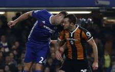 Chelsea's English defender Gary Cahill (L) and Hull City's English midfielder Ryan Mason clash heads during the English Premier League football match between Chelsea and Hull City at Stamford Bridge in London on 22 January 2017. Picture: AFP.