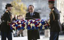 French President Francois Hollande (C), lays a wreath at the Tomb of the Unknown Soldier at the Arc de Triomphe, in Paris, on November 11, 2016 during the Armistice Day commemorations marking the end of World War I. Picture: AFP.