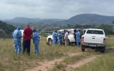 Forensic experts and police comb the scene of the where two police officers were taken, one fatally wounded while on duty in Inanda, Kwazulu Natal on 22 September 2015. Picture: SAPS.