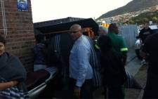 Forensic pathologists arrive to remove the body of a man who drowned when the Marashka boat capsized in Hout Bay on 13 October 2012. Picture: Malungelo Booi/EWN