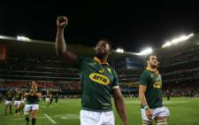FILE: Springbok flank Siya Kolisi greets fans as the team does a victory lap at Newlands. Picture: Bertram Malgas