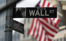 Wall Street sign near the New York Stock Exchange (NYSE) building in New York. Picture: AFP.