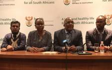 Health Minister Aaron Motsoaledi and Gauteng health MEC Gwen Ramokgopa (in the middle) brief the media on the move of some of Esidimeni patients. Picture: Masego Rahlaga/EWN.