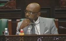 A screengrab shows Vincent Smith listening to deliberations in Parliament.