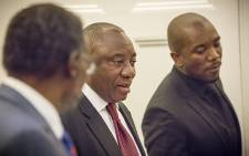 Parliamentary leader of the opposition Democratic Alliance, Mmusi Maimane, walks passed Deputy President Cyril Ramaphosa, at the beginning of a meeting with parliamentary leaders in the National Assembly in Cape Town. Picture: Thomas Holder/EWN.