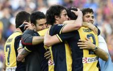Atletico de Madrid's football players celebrate their Spanish league title at the end of the Spanish league football match FC Barcelona vs Club Atletico de Madrid at the Camp Nou stadium in Barcelona on May 17, 2014. Picture: AFP.