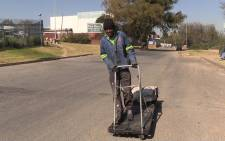 A man rides his recyclable waste trolley, many motorists find them a nuisance on the road, Picture: Vumani Mkhize/EWN.