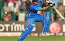 Indian cricketer Sachin Tendulkar plays a shot during the ICC Cricket World Cup 2011 match between England and India in Bangalore on 27/02/2011. Picture: AFP.