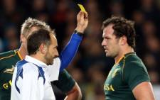 Bismarck du Plessis of South Africa (R) is yellow-carded by referee Romain Poite (L) during the Rugby Championship Test rugby union match between the New Zealand All Blacks and South Africa at Eden Park in Auckland on September 14 2013. Picture: Michael Bradley/AFP