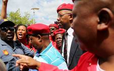 A scuffle broke out between EFF leader Julius Malema and a police officer outside the Independent Electoral Commission's offices in Centurion on Wednesday. The EFF were there to hand over their candidate list to the IEC in order to contest the elections on 7 May. Picture: EWN