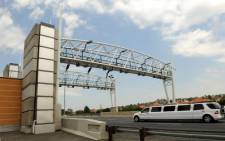 A limousine drives past a toll gantry along the N12 highway. A similar toll will be stup on the N1-N2 Winelands highway. Picture: Werner Beukes/SAPA
