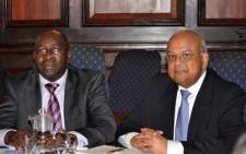 New Finance Minister Nhlanhla Nene with former minister Pravin Gordhan. Picture: GCIS.